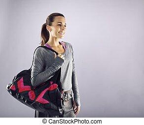 atleta, sala gimnastyczna, patrząc, torba, samica, uśmiechanie się, precz