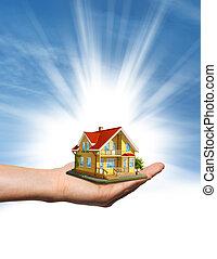 błękitny dom, na, niebo, ręka