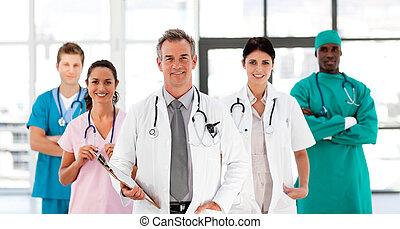 drużyna, patrząc, uśmiechanie się, aparat fotograficzny, medyczny
