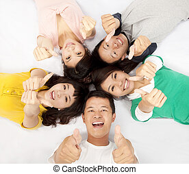 grupa, kciuk, ludzie, młody, razem, do góry, asian, leżący