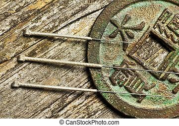 igły akupunktury, chińczyk biją