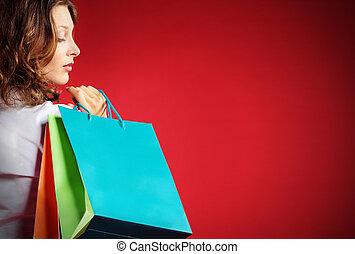 kobieta dzierżawa, przeciw, shopping torby, tło, czerwony