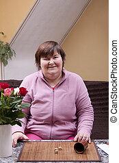 kobieta, niepełnosprawny, gra w kości, zabawa, ma, rzuty