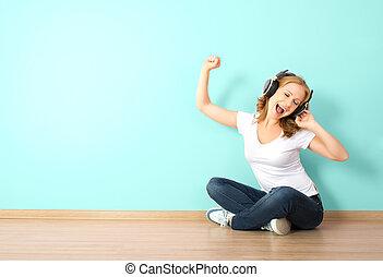 kobieta, pokój, ściana, słuchawki, młody, muzykować słuchanie, czysty, szczęśliwy