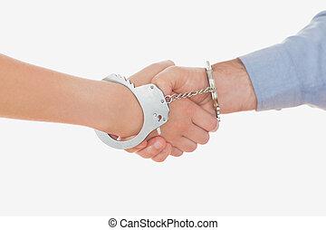 ludzie, handcuffed, potrząsanie, handlowy wręcza