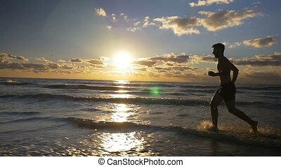 piękny, powolny, biegacz, trening, ruch, plaża, wschód słońca
