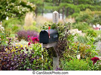 podniesiony, kwiaty, bandera, na, skrzynka pocztowa