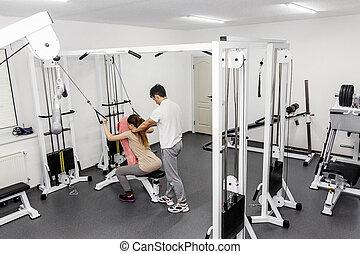 rehabilitacja, back., nowoczesny, terapeuta, pracujący, tekst, hyperextension, wyposażenie, stosowność, wykonuje, wellness, concept., clinic., sala gimnastyczna, terapia, rehab, ciężar, przestrzeń, trening, pacjent