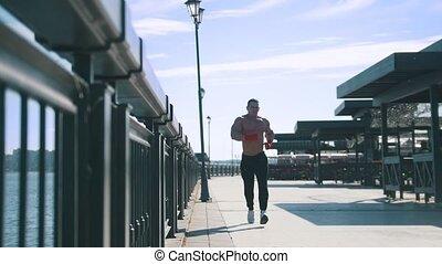 słoneczny, jogging, muskularny, deptak, dzień, awkwardly, człowiek