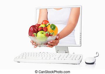 samica, ekran, owoce, ręka, komputer, dzierżawa, kropiąc